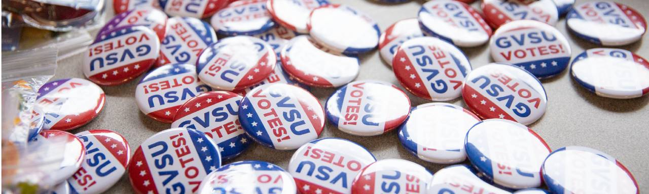 Red, white, and blue GVSU Votes buttons